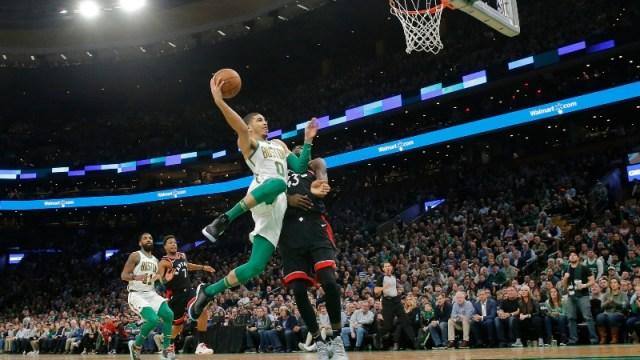 Boston Celtics forward Jayson Tatum (0) and Toronto Raptors forward Pascal Siakam (43)