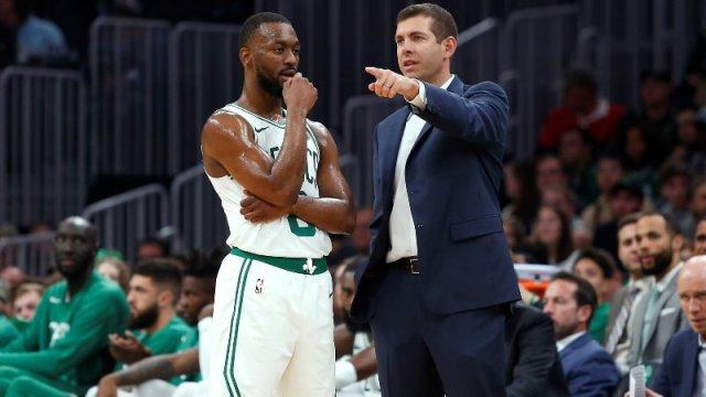 Boston Celtics' Kemba Walker and Brad Stevens
