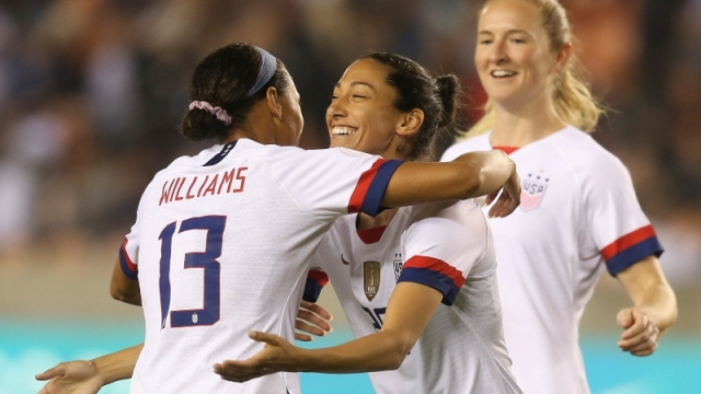USA forward Lynn Williams (13) and forward Christen Press (20)