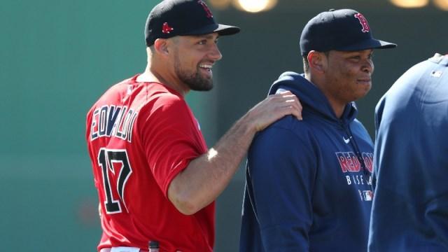 Boston Red Sox starting pitcher Nathan Eovaldi (17) and third baseman Rafael Devers (right)