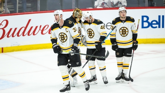 Boston Bruins goalie Tuukka Rask (40) and teammates