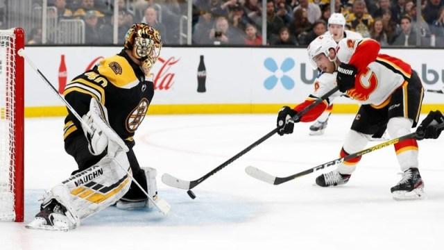 Boston Bruins goaltender Tuukka Rask, Calgary Flames center Elias Lindholm