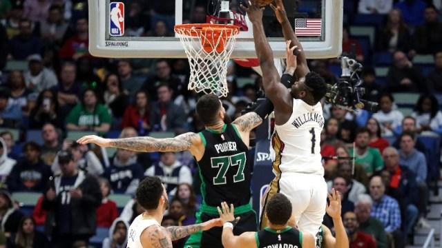 New Orleans Pelicans forward Zion Williamson (1) and Boston Celtics center Vincent Poirier (77)