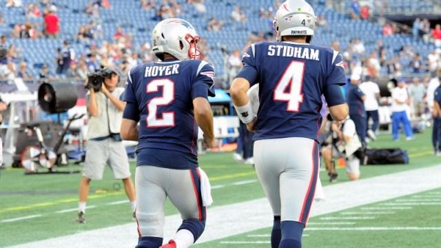 New England Patriots quarterbacks Brian Hoyer (2) and Jarrett Stridham (4)