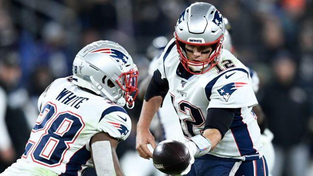 New England Patriots running back James White and NFL quarterback Tom Brady