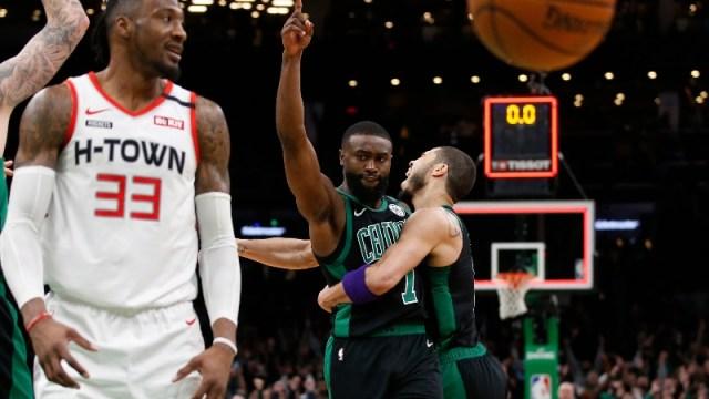 Boston Celtics forwards Jaylen Brown (center) and Jayson Tatum (right)