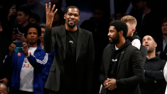 Brooklyn Nets forward Kevin Durant and guard Kyrie Irving (right)