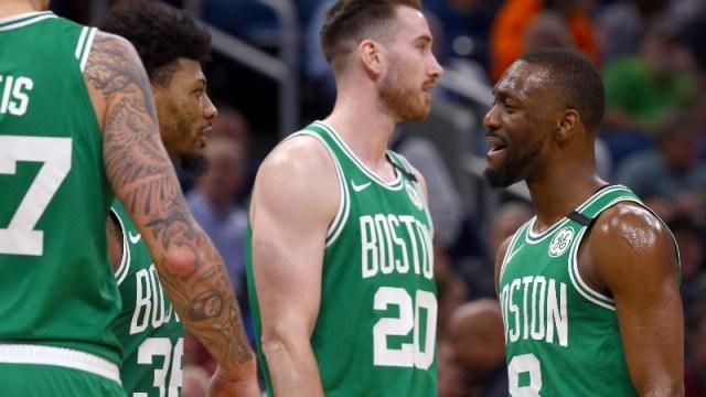 Boston Celtics guards Marcus Smart (left) and Kemba Walker (right) and forward Gordon Hayward (center)