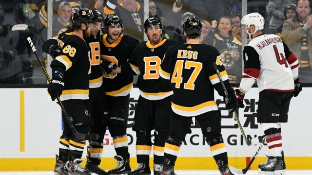 Boston Bruins center Patrice Bergeron (37), right wing David Pastrnak (88), left wing Brad Marchand (63), left wing Jake DeBrusk (74), and defenseman Torey Krug (47)