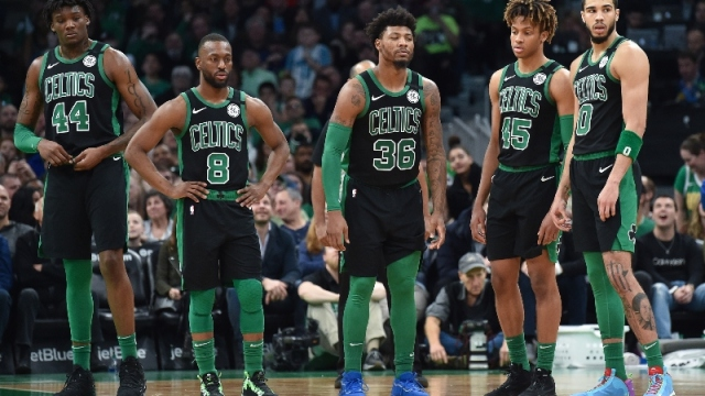 Boston Celtics center Robert Williams (44), guard Kemba Walker (8), guard Marcus Smart (36), guard Romeo Langford (45) and forward Jayson Tatum (0)