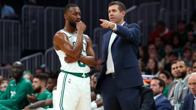 Boston Celtics point guard Kemba Walker and Brad Stevens