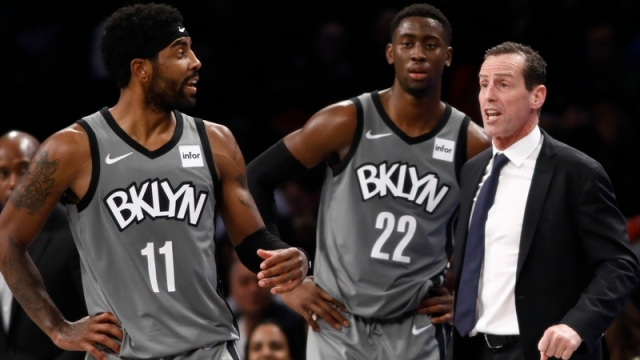 Brooklyn Nets guards Kyrie Irving, Caris LeVert; former Nets head coach Kenny Atkinson