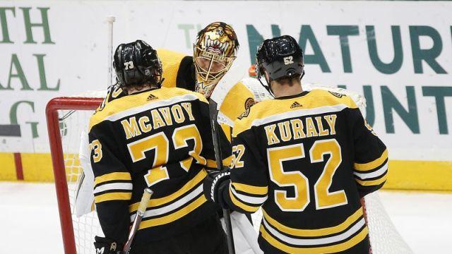 Boston Bruins' Tuukka Rask, Sean Kuraly, Charlie McAvoy