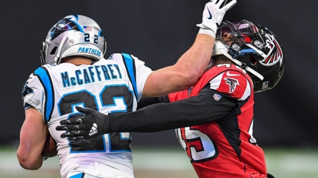 Carolina Panthers running back Christian McCaffrey (22) and Atlanta Falcons linebacker Deion Jones (45)