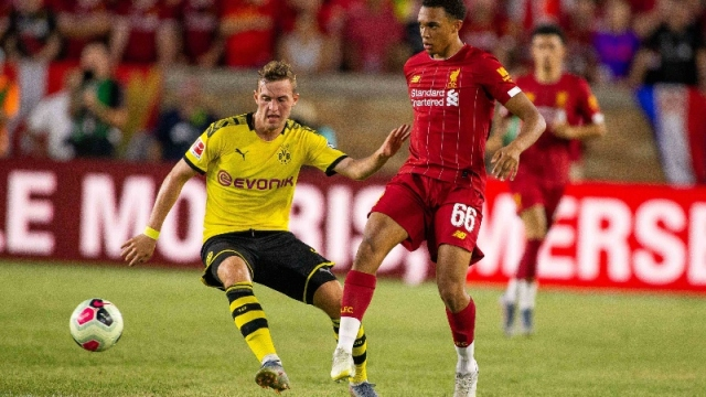 Liverpool defender Trent Alexander-Arnold (66) and Borussia Dortmund forward Jacob Bruun Larsen (34)