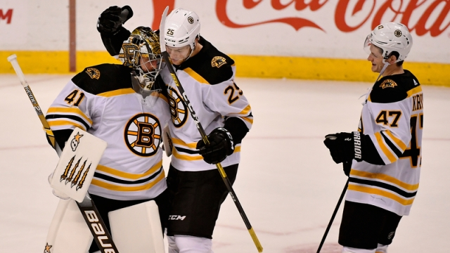 Bruins defensemen Torey Krug, Brandon Carlo