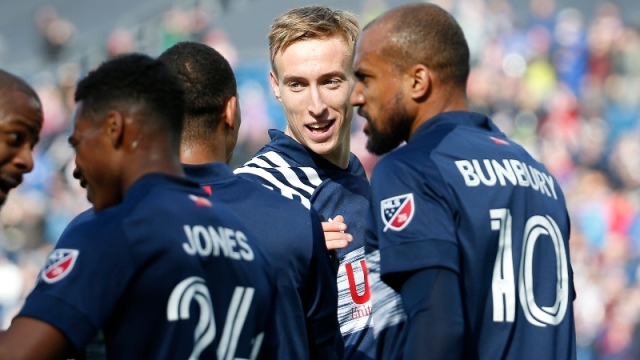 New England Revolution forward Adam Buksa (9) and teammates