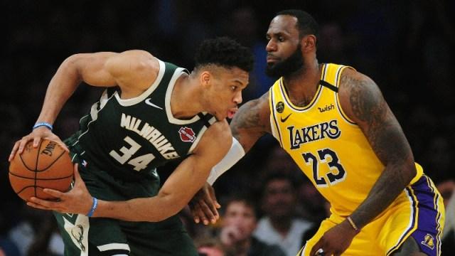 Milwaukee Bucks forward Giannis Antetokounmpo (left) and Los Angeles Lakers forward LeBron James