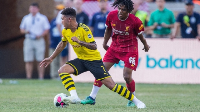 Borussia Dortmund midfielder Jadon Sancho (left) and Liverpool Liverpool forward Yasser Larouci