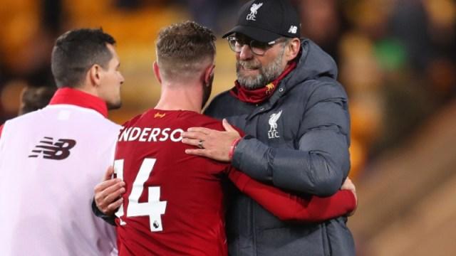 Liverpool midfielder Jordan Henderson (center) and manager Jurgen Klopp (right)