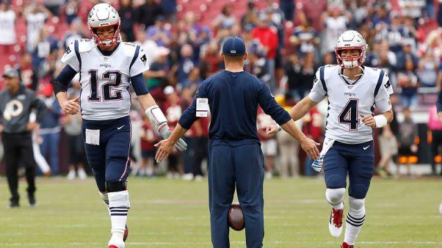 Tampa Bay Buccaneers quarterback Tom Brady and New England Patriots quarterback Jarrett Stidham