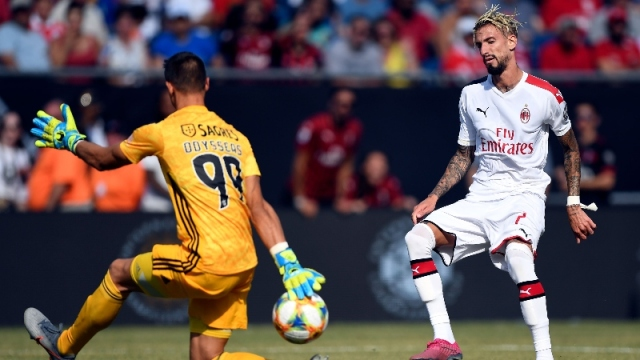 A.C. Milan forward Samu Castillejo (right) and Benfica goalkeeper Odisseas Vlachodimos