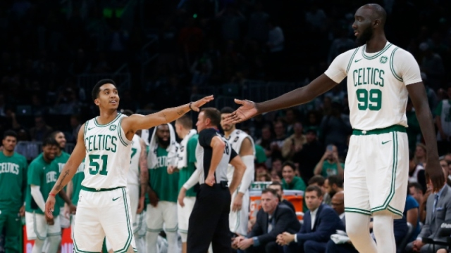 Boston Celtics center Tacko Fall (99) and point guard Tremont Waters (51)