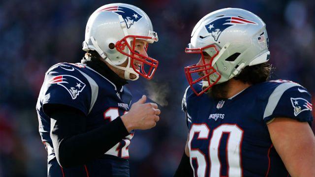 Tampa Bay Buccaneers quarterback Tom Brady and New England Patriots center David Andrews