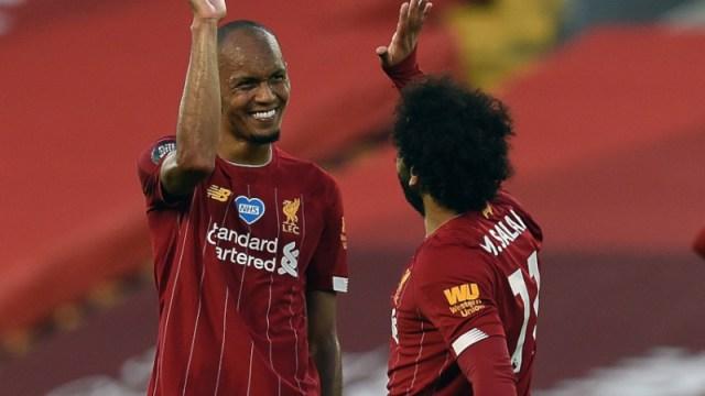 Liverpool midfielder Fabinho (left) and forward Mohamed Salah