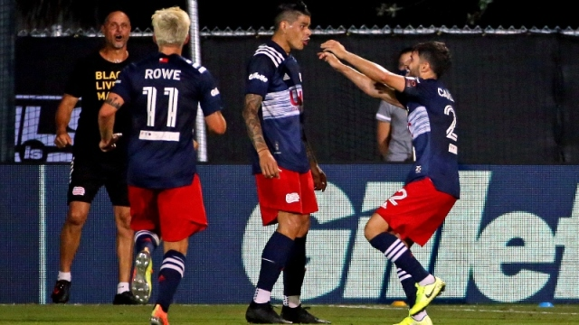 New England Revolution forward Gustavo Bou (7) and midfielders Carles Gil (22) and Keylyn Rowe (11)