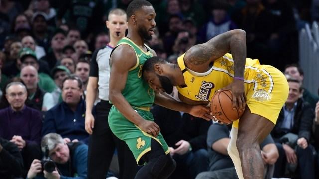 Boston Celtics guard Kemba Walker (left) and Los Angeles Lakers forward LeBron James