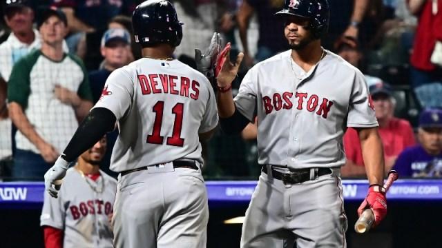 Boston Red Sox third baseman Rafael Devers (11) and shortstop Xander Bogaerts (2)