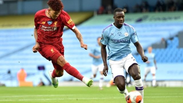 Liverpool forward Roberto Firmino (left) and Manchester City defender Benjamin Mendy