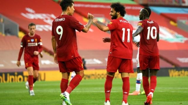 Liverpool forwards Roberto Firmino (left), Mohamed Salah (center) and Sadio Mane