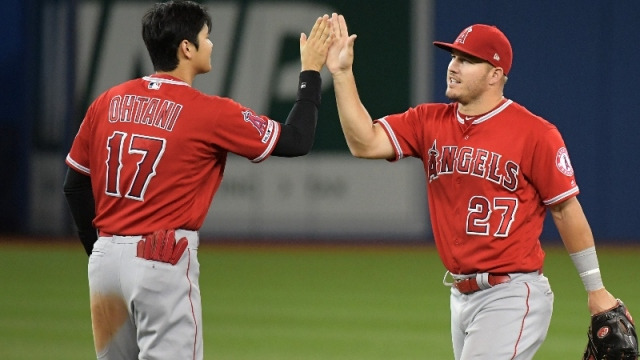 Los Angeles Angels center fielder Mike Trout (27) and designated hitter Shohei Ohtani (17)