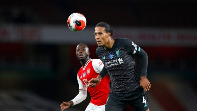 Liverpool defender Virgil van Dijk (right) and Arsenal forward Nicolas Pepe