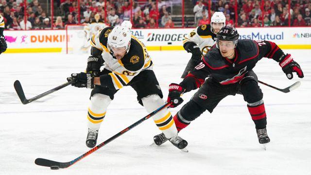 Boston Bruins left wing Brad Marchand and Carolina Hurricanes center Sebastian Aho