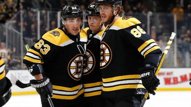 Boston Bruins right wing David Pastrnak (88), left wing Brad Marchand (63) and defenseman Torey Krug (47)