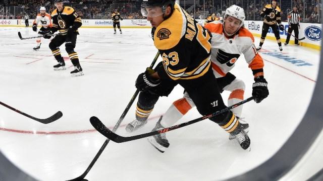 Boston Bruins left wing Brad Marchand and Philadelphia Flyers right wing Travis Konecny (11)
