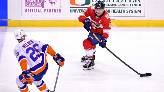 New York Islanders defenseman Brock Nelson and Florida Panthers center Aleksander Barkov
