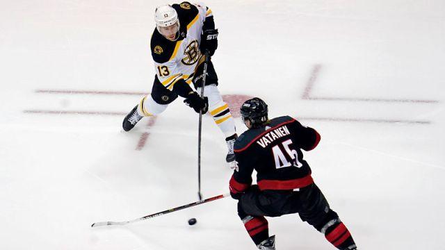 Boston Bruins center Charlie Coyle and Carolina Hurricanes defenseman Sami Vatanen