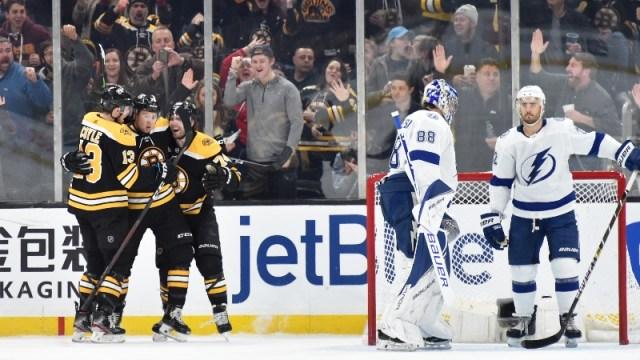 Boston Bruins defenseman Charlie McAvoy (73), center Charlie Coyle (13) and left wing Jake DeBrusk (74)