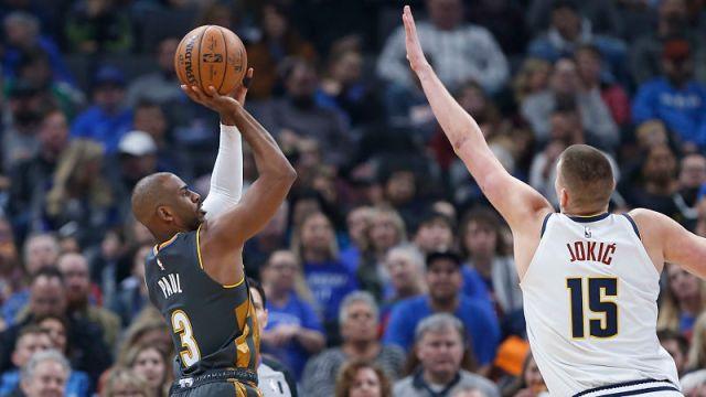 Oklahoma City Thunder point guard Chris Paul and Denver Nuggets center Nikola Jokic