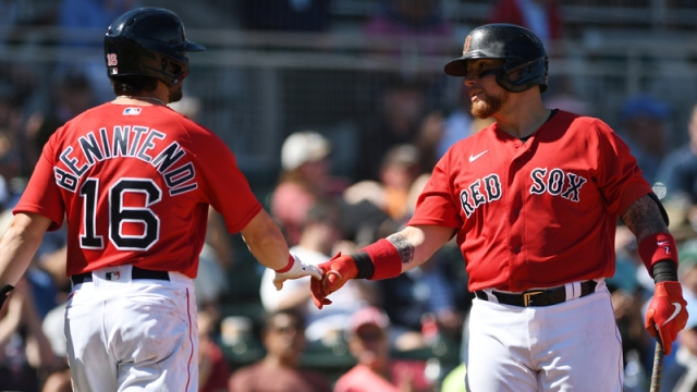 Boston Red Sox's Andrew Benintendi And Christian Vazquez