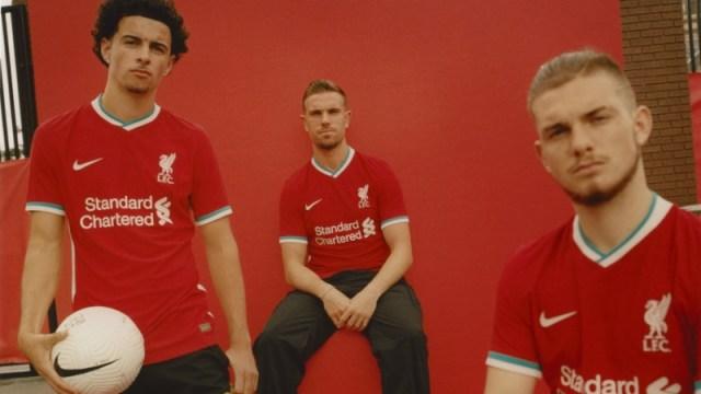 Liverpool midfielders Curtis Jones (left) and Jordan Henderson (center) and forward Harvey Elliot