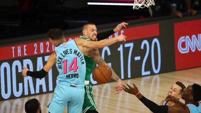 Boston Celtics center Daniel Theis (27) and Miami Heat guard Tyler Herro (14)