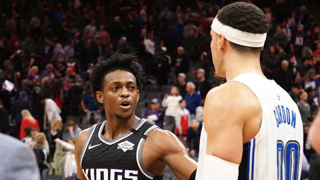 Sacramento Kings guard De'Aaron Fox and Orlando Magic forward Aaron Gordon