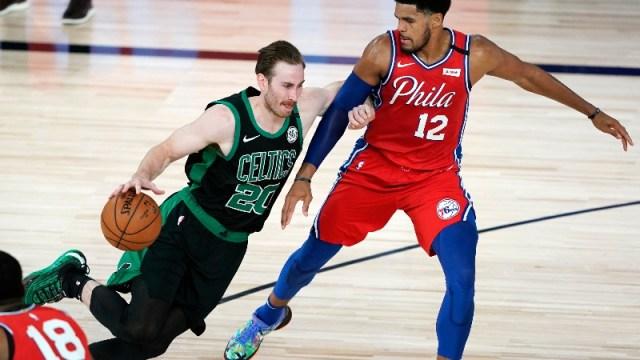 Boston Celtics forward Gordon Hayward (20) and Philadelphia 76ers forward Tobias Harris (12)