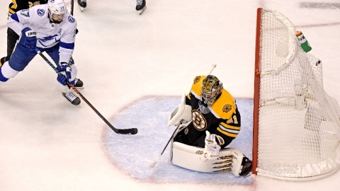 Boston Bruins goaltender Jaroslav Halak (41) and Tampa Bay Lightning center Alex Killorn (17)