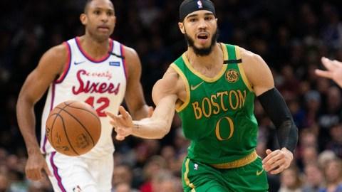 Boston Celtics forward Jayson Tatum (right) and Philadelphia 76ers center Al Horford